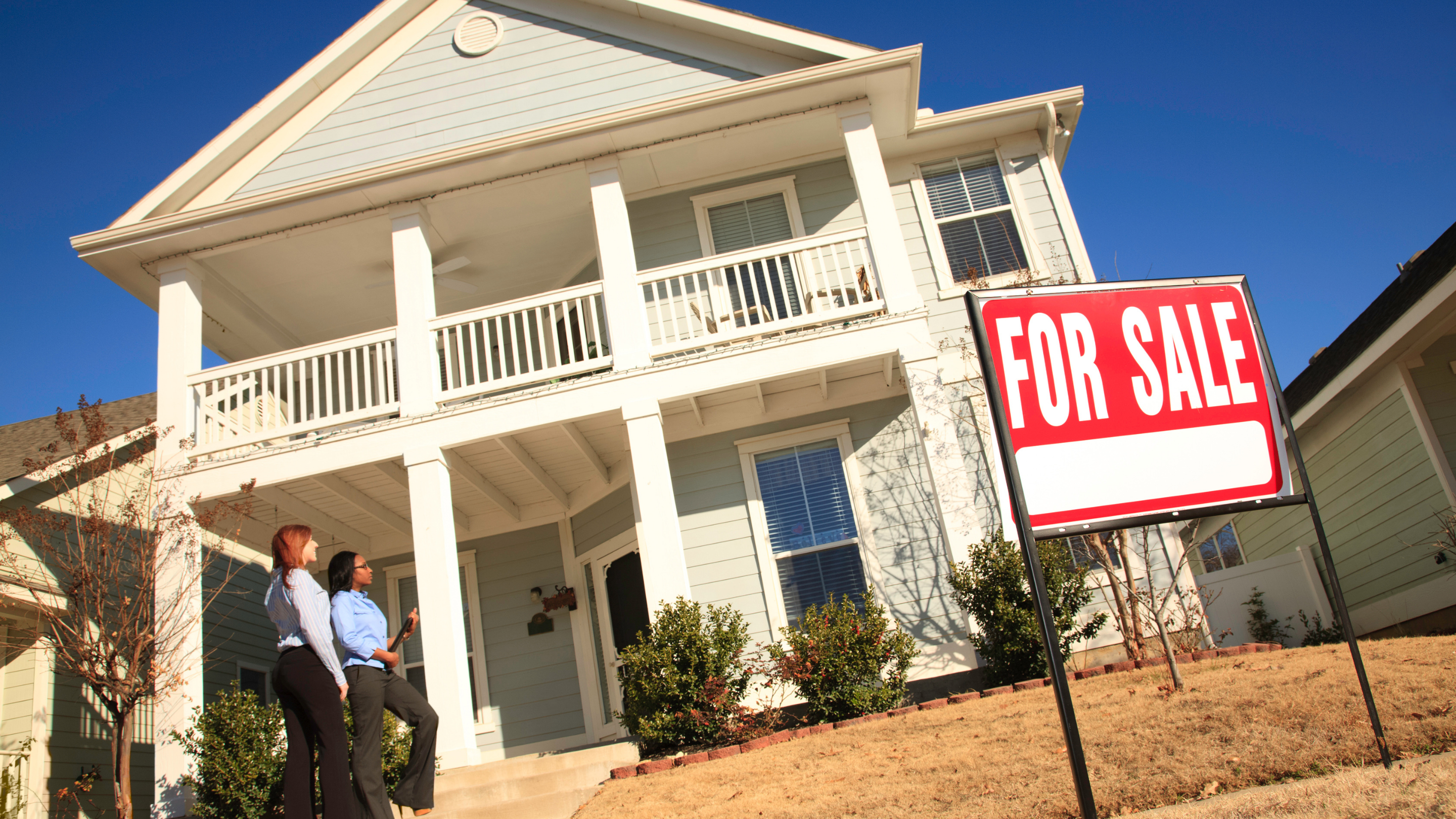 home buyer in front of a house