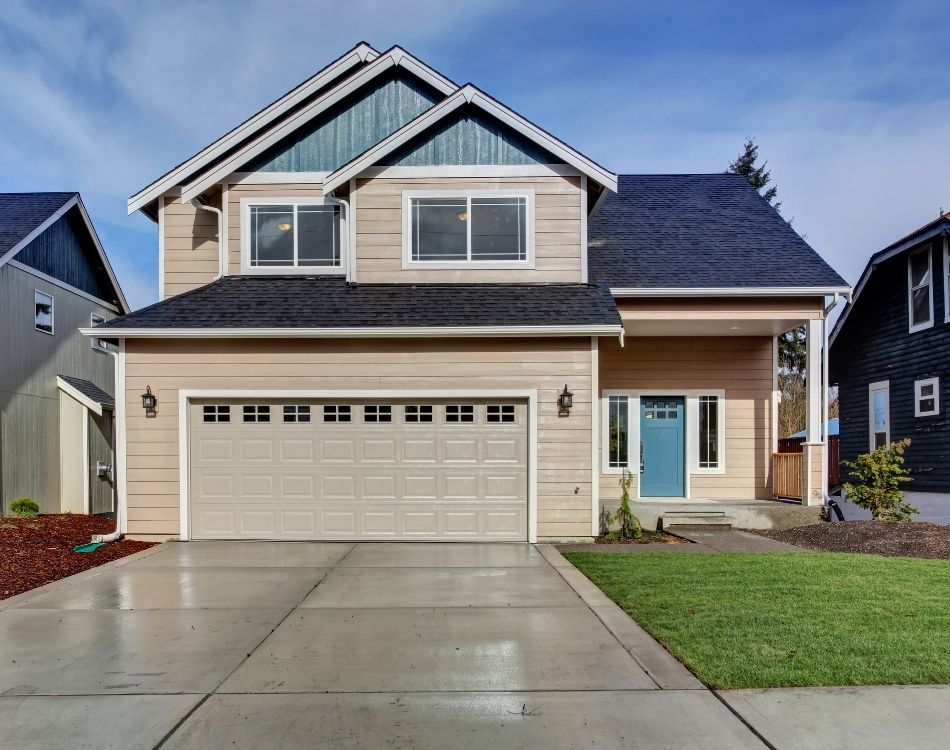 American beige house with green grass and garage with driveway. Sell your home